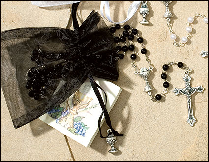 Black Communion rosary in bag