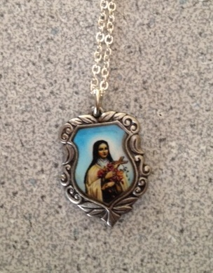 Silver tone engraved pendant of St Therese