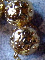 Medium sized gold tone filigree